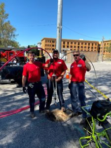 The plumbing experts at RooterNow team of Charleston, SC are preparing to do an inspection of a sewer.